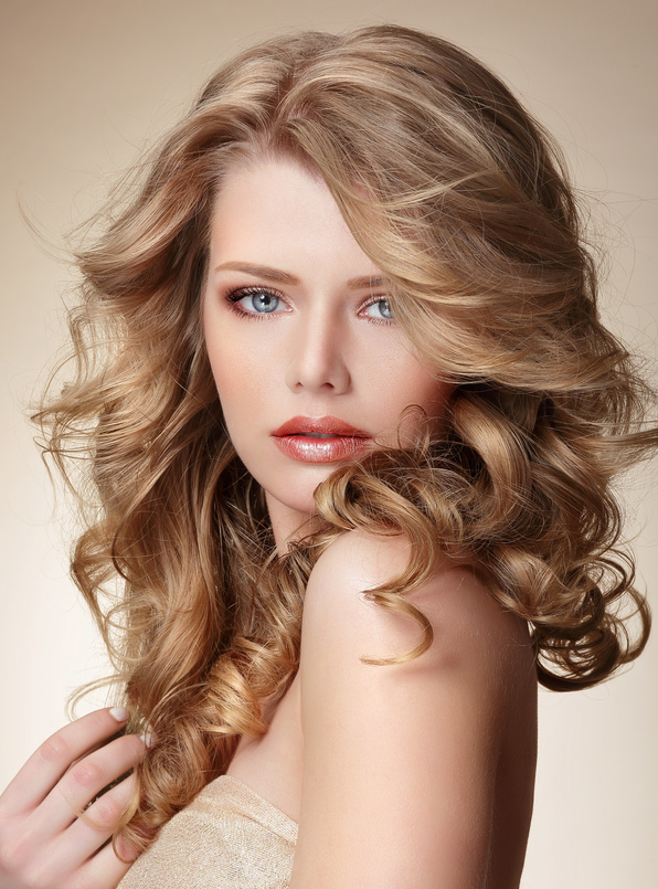 Sophisticated Woman with Perfect Skin and Flowing Blond Healthy Hair