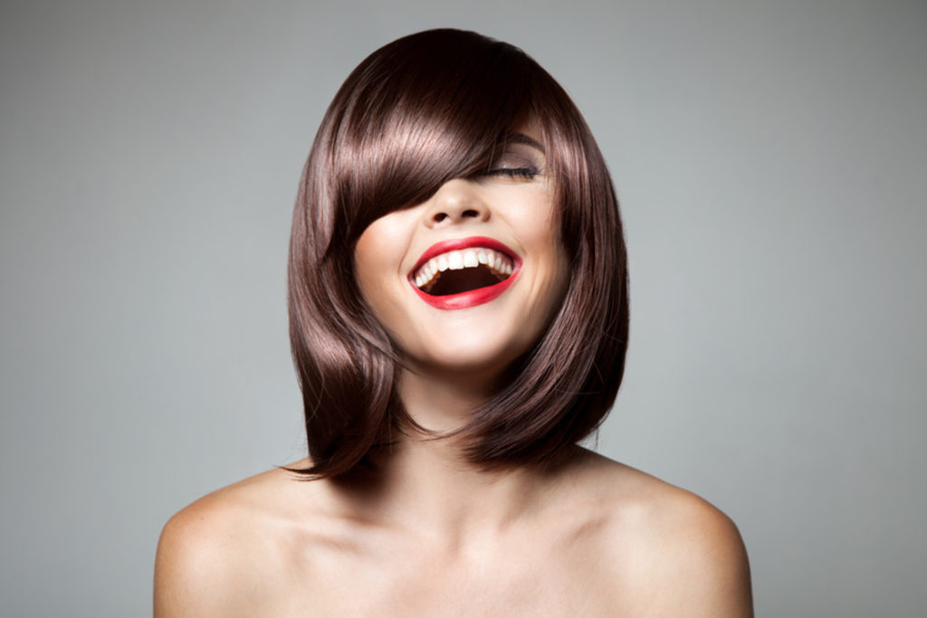 Smiling Beautiful Woman With Brown Short Hair. Haircut. Hairstyle. Fringe. Professional Makeup.